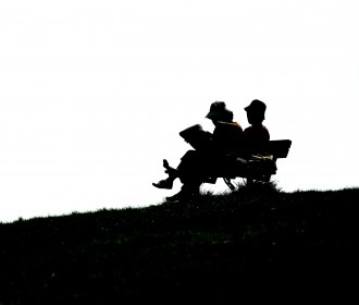 two people on a bench reading