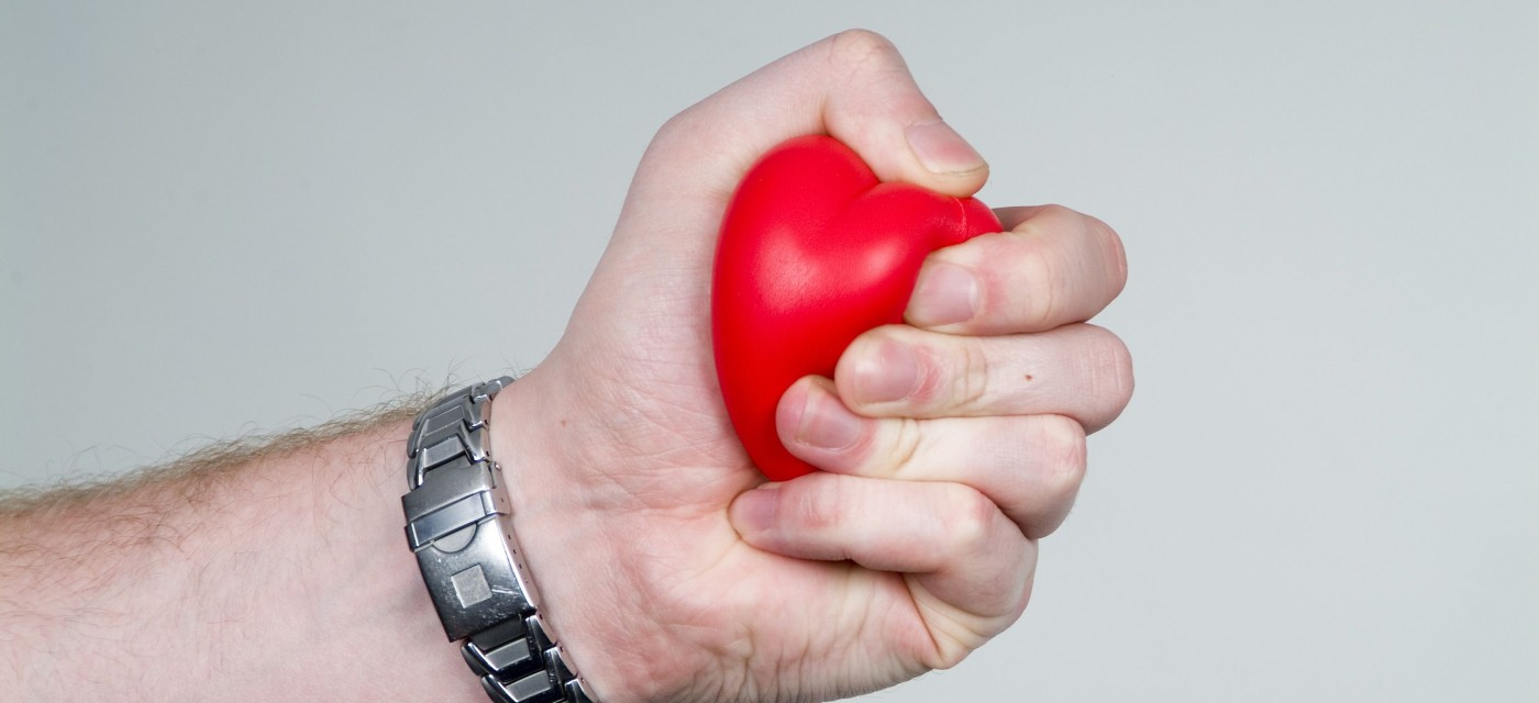 hand squeezing red stress ball