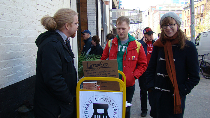 volunteer librarians on street in urban setting