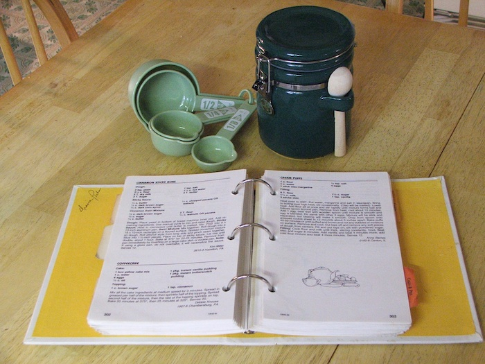 cook books and measuring cup
