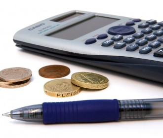 calculator, coins, and a pen