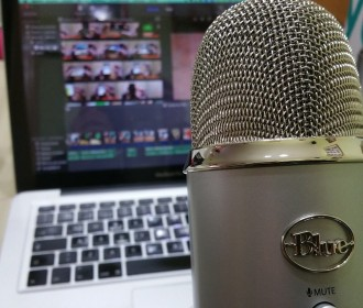 Microphone in front of a laptop screen