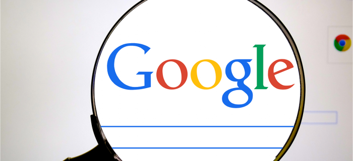 Google with magnifying glass