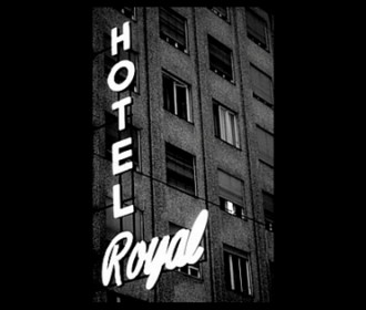 black and white image of hotel sign
