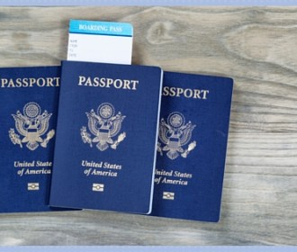 three u.s. passports and a boarding pass