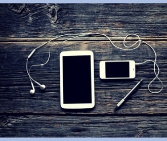 image of smartphone, tablet, and earbuds