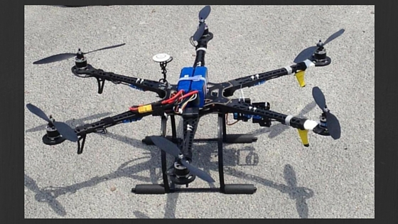 picture of a drone on a cement sidewalk