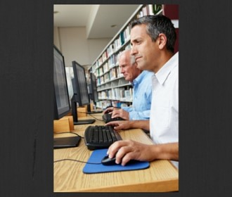 men working at computers in libraries