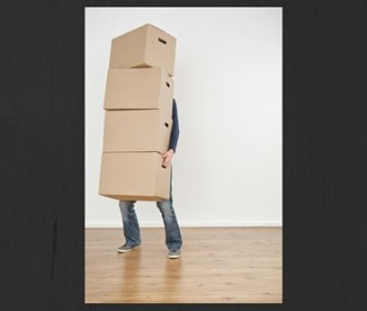 person holding several moving boxes