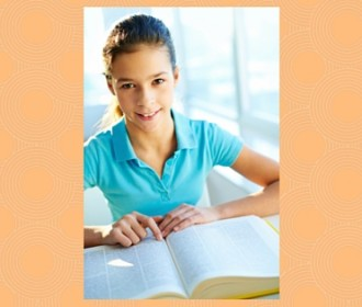 girl using large reference book