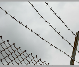barbed wire and high fence