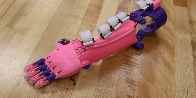 pink and purple prosthetic arm and hand