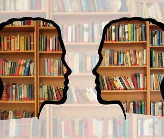 Silhouettes with books behind them