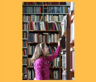 girl perusing library stacks