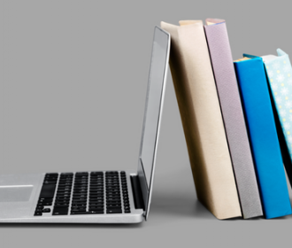 a laptop and a stack of books