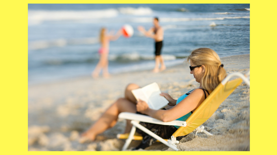 Woman in beach chair reading