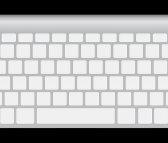 white keyboard on black background