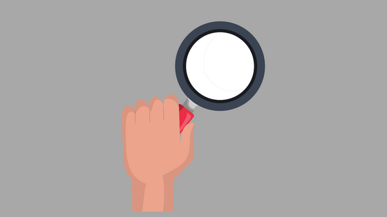 illustration of hand holding magnifying glass