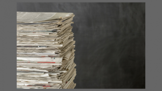 photograph of a stack of newspapers