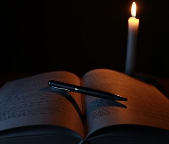 spooky book and candle
