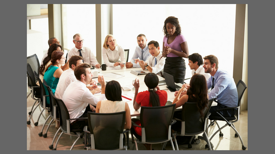 people around a table having a meeting