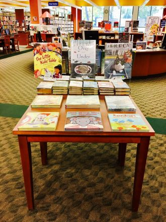 Table with neat book display
