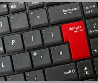 black keyboard with red 'danger' key