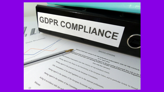 Binder label that says GDPR Compliance on top of papers that say regulations