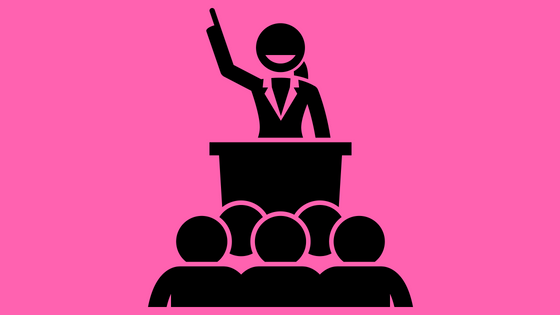 illustration of a woman at a podium speaking to a group
