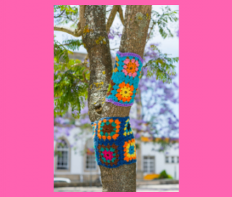 Tree with a knitted afghan on its branches