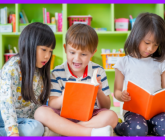 children looking at a book