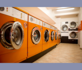 photo of a laundromat with large orange machines