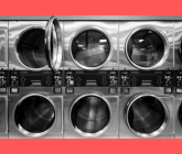a wall of dryers at a laundromat