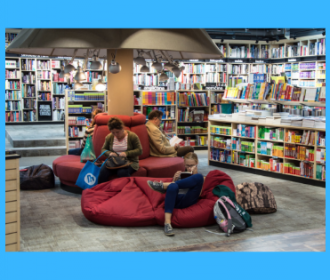 photograph of various people reading in a library