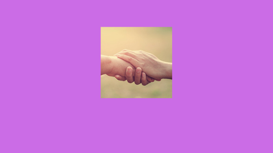a photo of two hands clasped