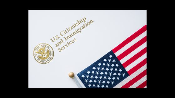 image of an american flag with the words U.S. citizenship and immigration services above it in gold