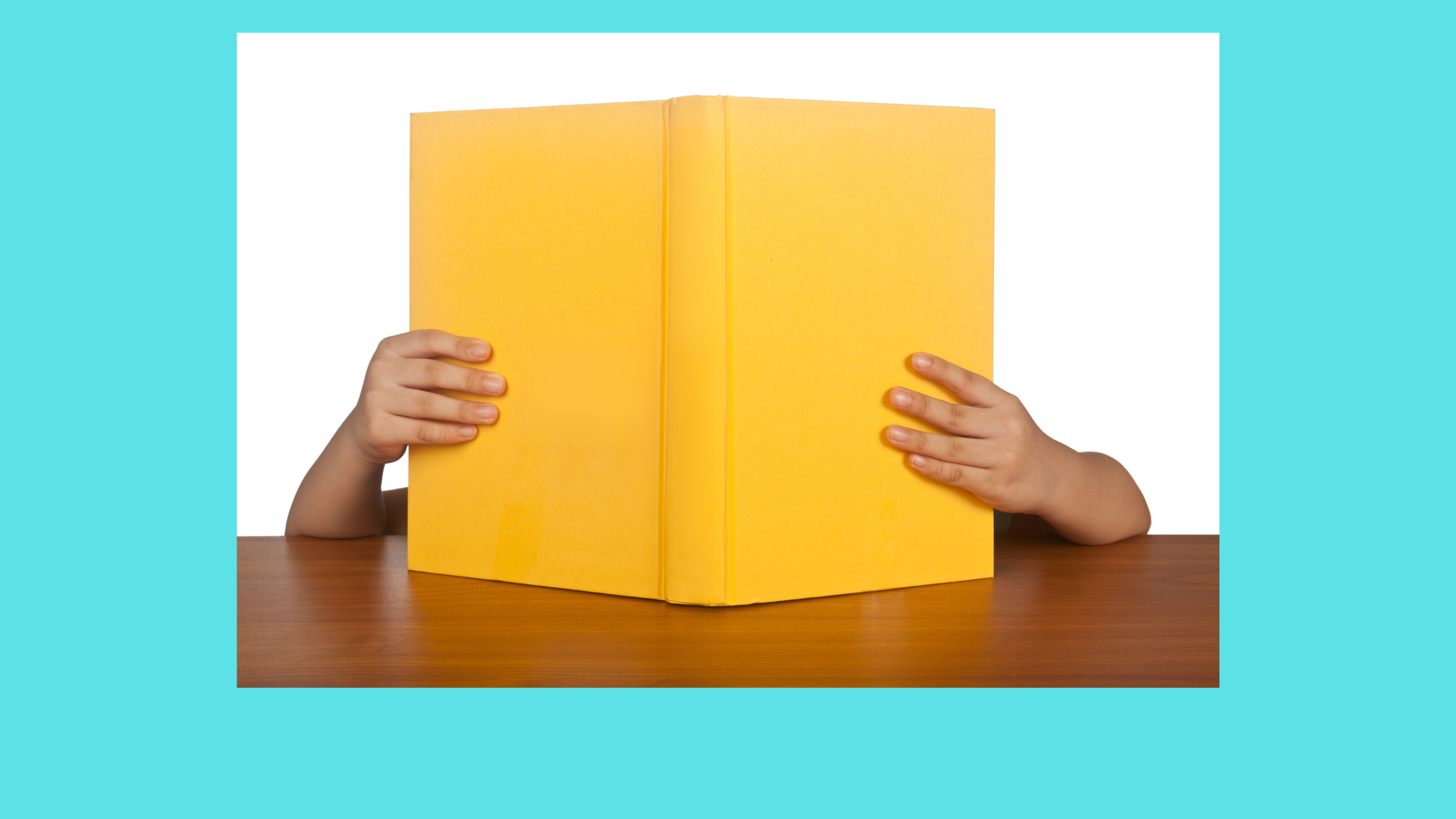 a child's arms holding/reading a yellow book