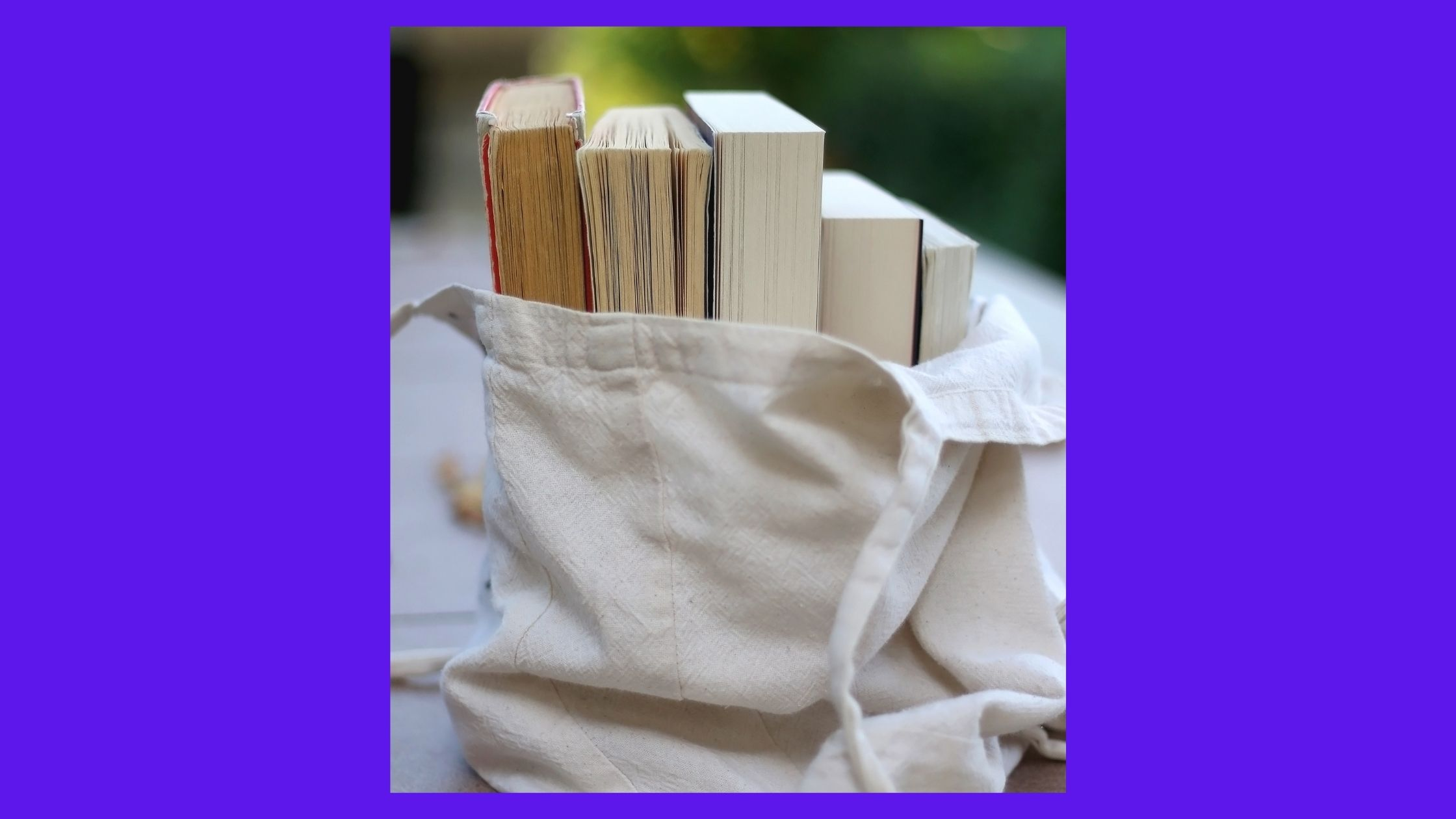 photo of a book bag with books showing